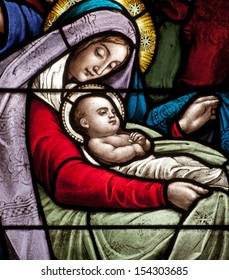 Detail of stained glass window depicting Christmas scene, the infant Jesus with Mary