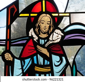 Detail of stained glass window of Jesus Christ as the Good Shepherd