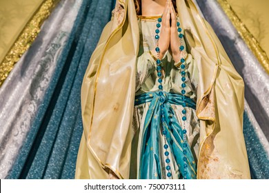 detail of statue of Our Lady of Medjugorje, the Blessed Virgin Mary, with Rosary