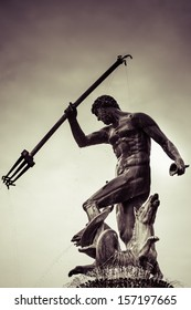 Detail of the statue of Poseidonon in Gdansk on a rainy and cloudy sky in the background, Poland