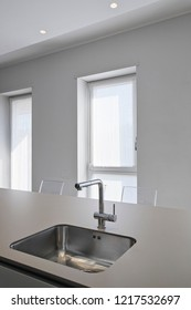 detail of a steel sink with faucet in the modern kitchen
