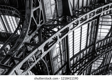 Detail of the steel structure of the Milan central station roof. Black and white picture, urban texture
