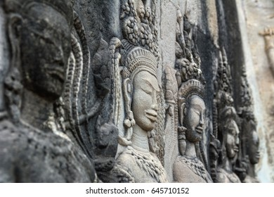 Detail of a Stone Carved Relief in the famous Angkor Wat in Cambodia and the largest religious monument in the world. Location: Siem Reap, Cambodia. Artistic picture. Shallow depth of field