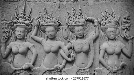 Detail of a Stone Carved Relief at the Landmark Angkor Wat in Cambodia.
