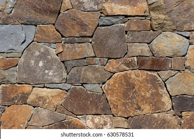 Detail of a stone wall with different size of rocks.