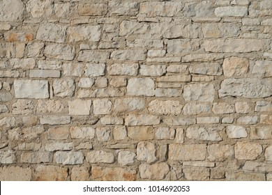Detail of the stone wall texture made of the angled limestone blocks