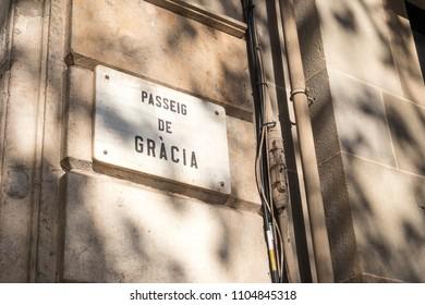 Detail of street sign of Passeig de Gracia (Gracia's Avenue) in Barcelona, Spain.