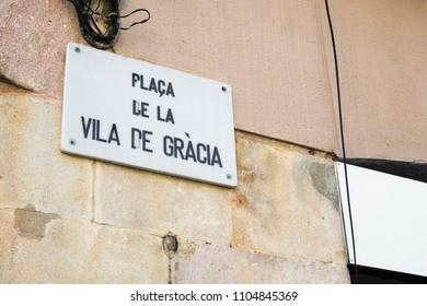 Detail of street sign of Vila de Gracia Square in Barcelona, Spain.