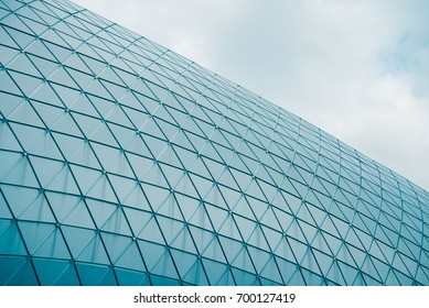 Detail of structural metal facade curving roof of modern building. Modern contemporary architectural.