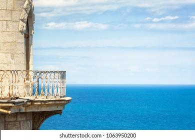 Detail of Swallow's Nest castle with seascape in summer, Crimea, Russia. Famous castle on the rock in Black Sea. Crimea landmark. Balcony of castle over the sea. Beautiful idyllic Crimea background.