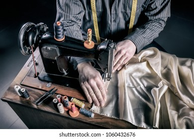 detail of tailor at work with sewing machine