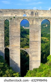 Detail of tall aqueduct (Ponte delle Torri) across a valley in Spoleto, Umbria, Italy