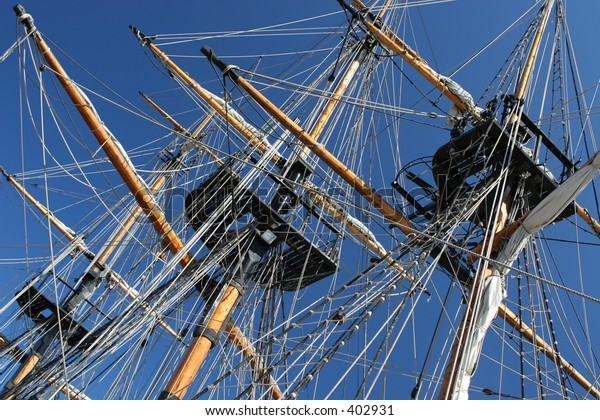 Detail of tall sailing ship against a blue sky background