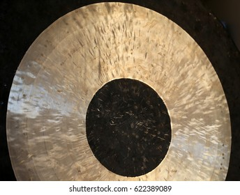 Detail of a Tam-Tam Gong Musical Instrument with black metal in middle, gold coloured metal as a circle and black outer ring for Gong Meditation