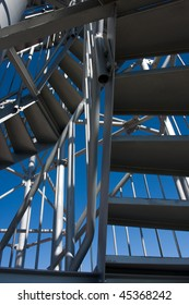 Detail of Telecommunication tower with lookout and blue sky