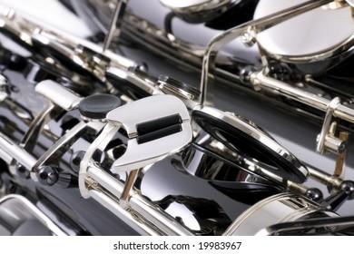 Detail of Tenor Saxophone on white background