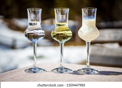 Detail of three flavored Grappa (Schnapps) glasses in Cortina d'Ampezzo, Dolomites, Italy