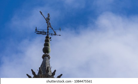 Detail of the top of the tower of Toledo's cathedral, Spain. Image also filled with the beautiful blue sky of the Spanish winter.