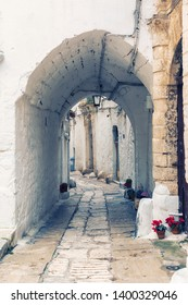 detail of town ancient wall of  Italian city Ostuni in Apulia ( the White Town)