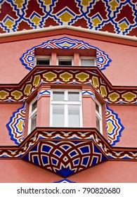 Detail of a townhouse in Ljubljana decorated with colorful ornaments
