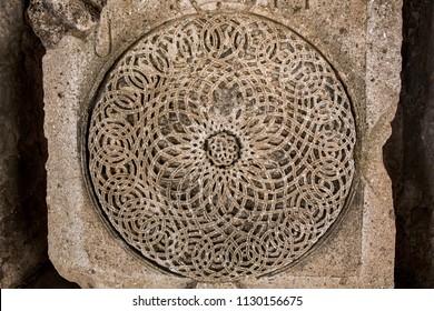 Detail of traditional Armenian rock carving. Armenian cross stone - Khachqar. Art and craft concept