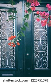 Detail of a traditional house door with flowers