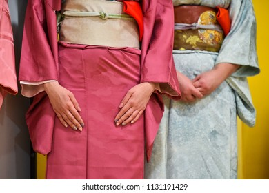 Detail with traditional kimonos during tea ceremony