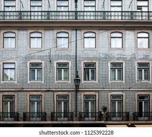 Detail of a traditional tile facade in the Caixa district in Lisbon, Portugal.