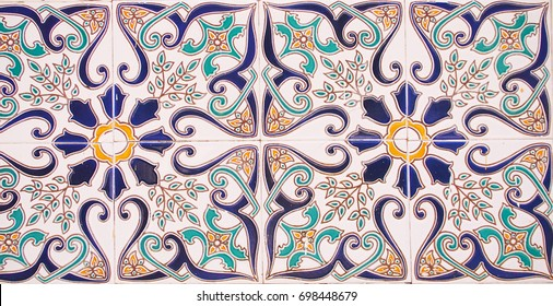 Detail of the traditional tiles from facade of old house. Decorative tiles.Valencian traditional tiles. Floral ornament. Majolica, Watercolor