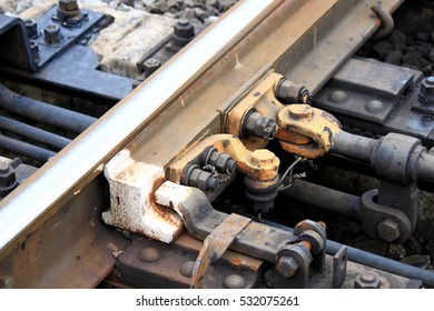 Detail of turnouts (railroad switch). A switch machine, wit and