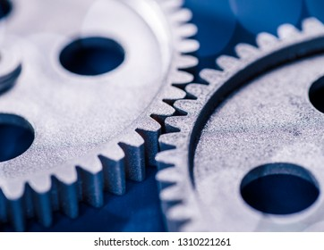 Detail of two gears meshing with each other.