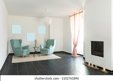 Detail of two turquoise armchairs in empty apartment. Nobody inside.