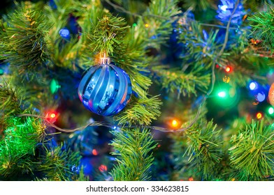 Detail of a typical christmas tree with colored baubles and lights
