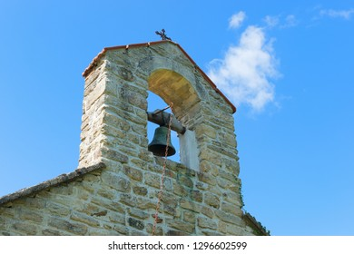 Detail Typical Medieval chapel with bell in French village in Limousin