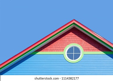 Detail of the typical style of colourful houses in Iles de la Madeleine, or the Magdalen Islands, Canada. Minimalistic style in blue, red and green with space for text.