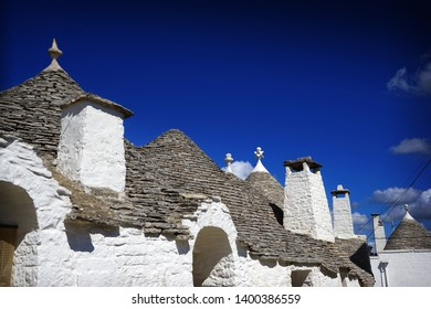Detail of typical trulli houses with conical roof in Alberobello, Apulia, Italy