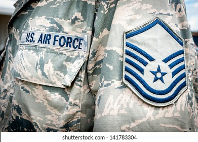 Detail of United states air force soldier's uniform with emblem in focus.