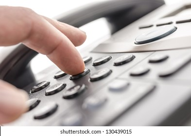 Detail of using a telephone keypad. Shallow dof.