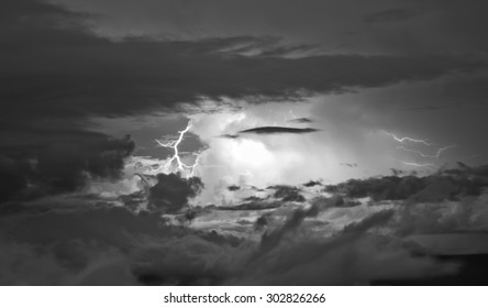 Detail of a very active thunderstorm, with a lightning, in Venezuela. Cumulonimbus cloud type. Black and White