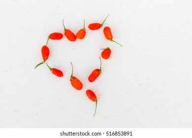 Detail view of arranged Goji berries on a white background
