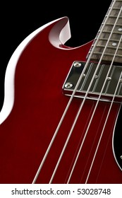 Detail view of electric bass on black