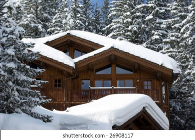Detail view of a luxurious log cabin in the Alps in France.