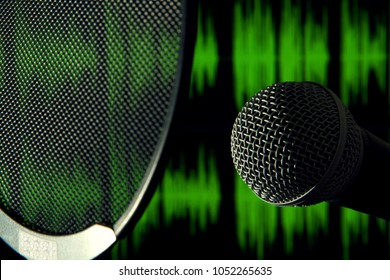 Detail view of microphone head with a pop filter in front and green sound waves on the background