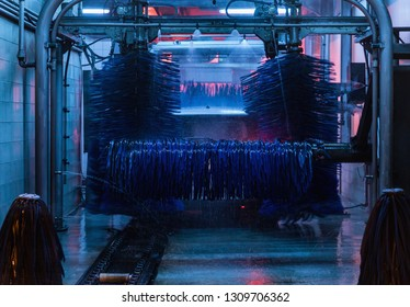 Detail view on car wash, car wash foam water, Automatic car wash in action, Modern Brush Car Wash Blue Color Graded Concept. Washing machine in dishwasher