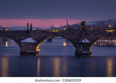 Detail view on illuminated Charles bridge at winter dusk, Prague