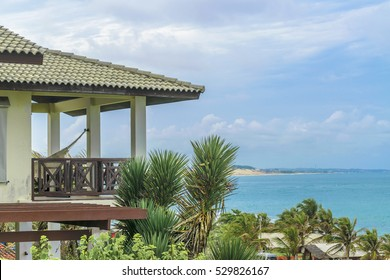 Detail view of roof and balcony of elegant waterfront house at top of hill in Tibau do Sul, a watering place located in Brazil