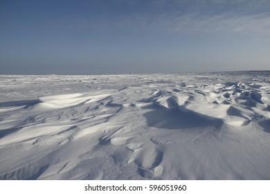 Detail view of Sastrugi, wind carved ridges in the snow, near Arviat, Nunavut
