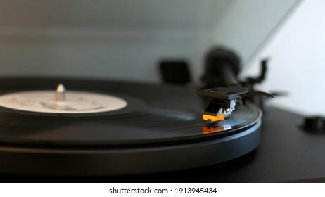 Detail view of turntable stylus needle on vinyl lp