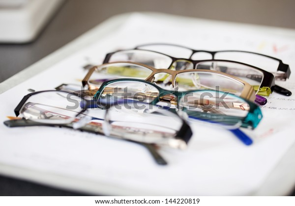detail view of various eyeglasses lying on a tray