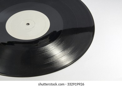 Detail view of vynil record, with blank space at right
